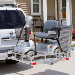 Support pour fauteuil roulant ou quadriporteur